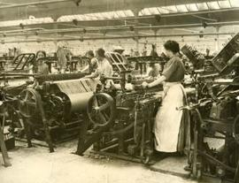 Interior view of weaving shed showing women at looms