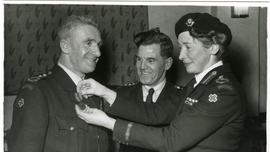 Margot Cox awarding a Red Cross medal